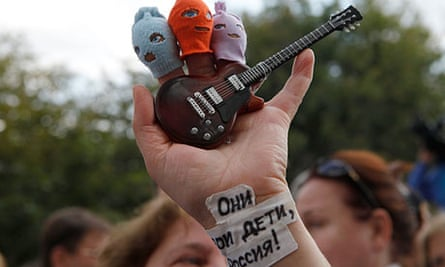 A Pussy Riot supporter holds finger puppets of the punk band