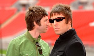 Noel and Liam Gallagher look past each other in an empty arena