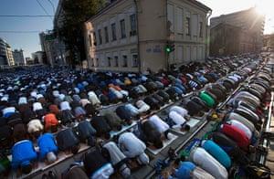 Eid al-Fitr begins: Muslim men, bowing toward Mecca, perform Eid al-Fitr prayers in Moscow