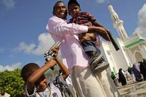 Eid al-Fitr begins: Somali children play with toy guns in Mogadishu, Somalia