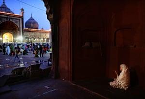 Eid al-Fitr begins: An Indian Muslim woman prays after breaking fast