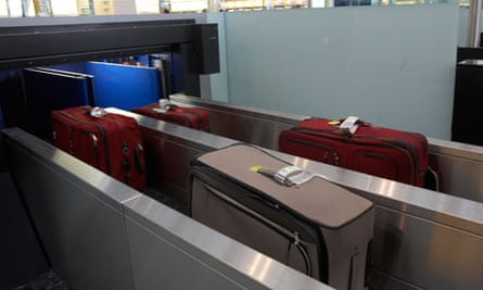 Suitcases going through the X-ray machine at Terminal 5 at Heathrow Airport