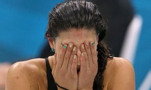 Australian Olympic swimmer Stephanie Rice leaves the pool dejected
