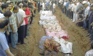 People gather during the mass burial of people whom activists say were killed by forces loyal to President in Assad in Jdeidet Artouz