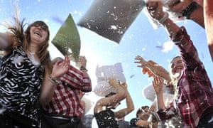 People attend a flash-mob pillow fight