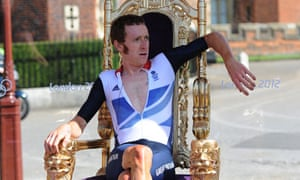 Bradley Wiggins relaxes in the winner's throne after the men's cycling time trial