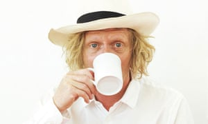 Grayson Perry with tea cup in hand