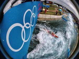 Dan Chung Gallery: Spain's Samuel Hernanz paddles under the Olympic rings