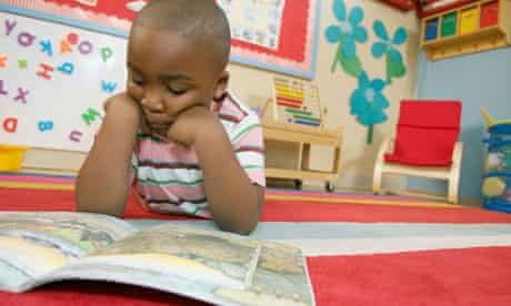 Preschool boy reading