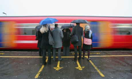 Commuters wait to squeeze on to the next train to Victoria Station at Clapham Junction, south London