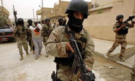 Iraqi troops escort suspected al-Qaida leader