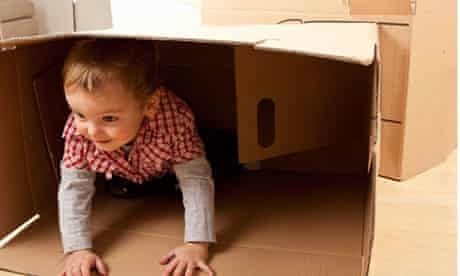 Child playing in box