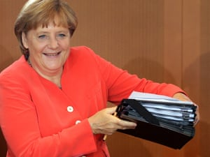 German Chancellor Angela Merkel arrives for the weekly cabinet meeting at the chancellery in Berlin, Germany, Wednesday, Aug. 22, 2012.