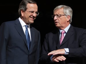 Greek Prime Minister Antonis Samaras, left, welcomes Jean Claude Junker, Prime Minister, of Luxembourg and President of Eurogroup prior their meeting in Athens, on Wendesday, Aug. 22, 2012.