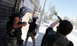 Syrian rebels fire towards a pro-government sniper in the Seif El Dawla district in the center of Aleppo.