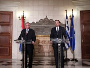 Greek Prime Minister Antonis Samaras (L) and Eurogroup president Jean Claude Juncker (R) speak during a press conference after their meeting in Maximos Mansion (government headquarters) in Athens, Greece, 22 August 2012.