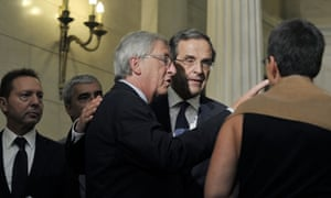 Eurogroup chief Jean-Claude Juncker (C) talks with  Greek Prime Minister Antonis Samaras (C,R)  while Greek Finance minister, Yiannis Stournaras (L) looks after their meeting in Athens on August 22, 2012.