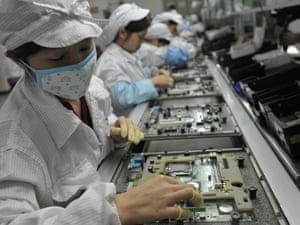This photo taken on May 27, 2010 shows Chinese workers in the Foxconn factory in Shenzhen, in southern China's Guangdong province.