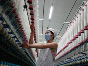 A labourer works at a textile mill in Huaibei, Anhui province August 1, 2012.