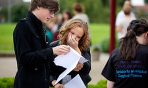 Pupils at Ysgol Morgan Llywd in Wrexham collecting their GCSE results on 23 August 2012.