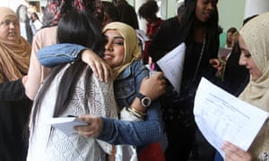 Students at the Elizabeth Garrett Anderson School for Girls in London collect their GCSE results