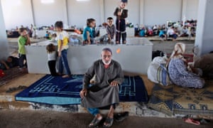 An elderly Syrian man, who fled his home due to fighting between the Syrian army and the rebels, takes refuge at the Bab Al-Salameh border crossing, in hopes of entering one of the refugee camps in Turkey.
