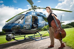 Mittwoch aus Licht: A woman holding cello by a helicopter