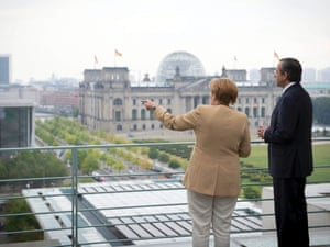 German Chancellor Angela Merkel talks with Prime Minister of Greece Antonis Samaras, right, on the terrace of the federal chancellery in Berlin, Germany, Friday, Aug. 24, 2012. Building in the background is the German parliament Reichstag