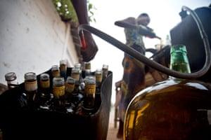 Adolphus: Selling fuel in bottles in Ouidah, Benin Republic