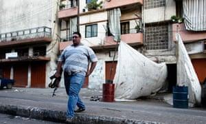 A Lebanese man crosses Syria Street, Tripoli