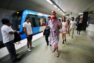 Zombie walk: Zombies arrive for the walk by metro