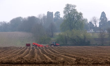 A tractor in a ploughed field near Hoxne in Suffolk