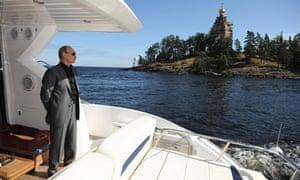 Vladimir Putin on a boat in Karelia