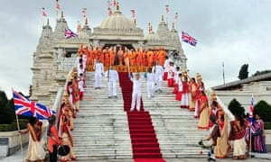 Torchbearing team 056 Barrie Guy, Antony Eames, and others outside the Shri Swaminarayan Mandir temple in Neasden, as they carry the Paralympic Flame during the Torch Relay leg through Brent