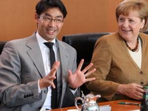 German Chancellor Angela Merkel (R) and German Economy Minister Philipp Roesler