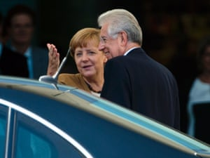 German Chancellor Angela Merkel, left, welcomes Italy's Prime Minister Mario Monti for talks about the European financial crisis at the chancellery in Berlin, Wednesday, Aug. 29, 2012. (AP Photo/Markus Schreiber)