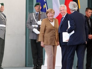 German Chancellor Angela Merkel (C) greets Italian Prime Minister Mario Monti (4L) as arrives for a meeting with her at the German federal Chancellory on August 29, 2012 in Berlin, Germany.
