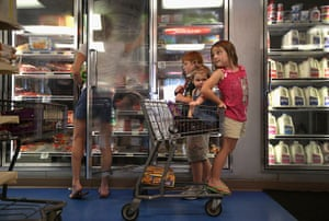 Tropical storm Isaac: Family shops for frozen items at Seal's Marketplace in Kiln, Mississippi