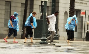 Tropical storm Isaac: People make their way across Canal Street in New Orleans