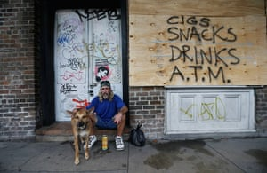 Tropical storm Isaac: Homeless man by a boarded up store in the French Quarter