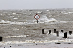 Tropical storm Isaac: A storm surge causes tides to rise and rough waves in Lake Pontchartrain