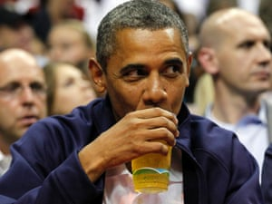 President Barack Obama sips his beer as he watches Team USA and Brazil during the first half of an Olympic men's exhibition basketball game, Monday, July 16, 2012, in Washington.