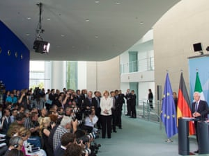 German Chancellor Angela Merkel (R) and Italy's Prime Minister Mario Monti (2nd R) attend a news conference after talks at the Chancellery in Berlin, August 29, 2012.