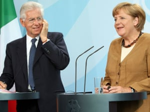 Italian Prime Minister Mario Monti (L) listens during a news conference with German Chancellor Angela Merkel at the German federal Chancellory on August 29, 2012 in Berlin, Germany.
