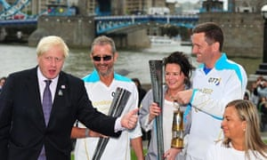 Boris Johnson with the Paralympic torch outside City Hall on 29 August 2012.