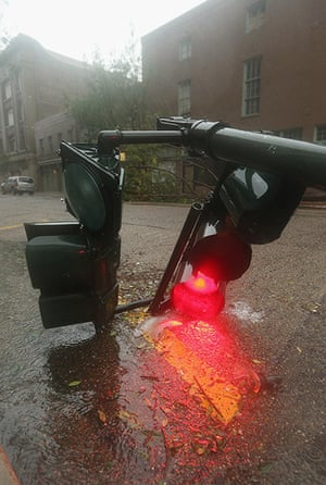Isaac update: A downed streetlight lies in the rain in New Orleans