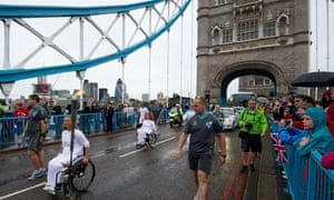 The Paralympic flame is carried across Tower Bridge in central London on 29 August 2012.
