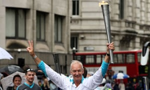 Jon Snow with the Olympic torch on the leg between the City and Tower Hamlets on 29 August 2012.