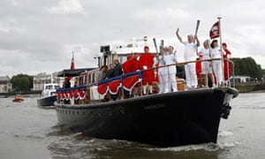 The Paralympic torch on a boat on the Thames between Lewishan and Greenwich on 29 August 2012.