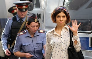 Pussy Riots: Nadezhda Tolokonnikova is escorted to a police van in Moscow